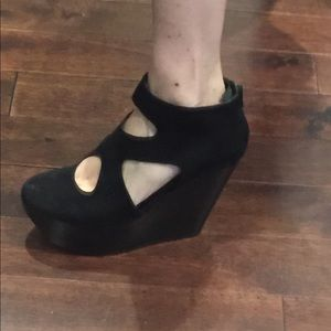 Black suede platform shoes